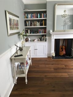 An inspirational image from Farrow and Ball. Light Blue on walls Strong White below dado rail and (&; An inspirational image from Farrow and Ball. Light Blue on walls Strong White below dado rail and (&; In the […] Room blue farrow and ball Dado Rail Living Room, Farrow And Ball Living Room, My Living Room, Home And Living, Dado Rail Bedroom, Dado Rail Hallway, Living Walls, Alcove Cupboards, Light Blue Walls