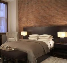 Brown contemporary bedroom, exposed bricks, masculine