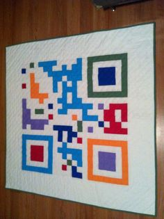 Custom made QR code quilt on Etsy. I like the colorfulness of this one. Been meaning to try something like this.