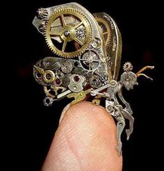 Sue Beatrice of New Jersey makes incredible steampunk animals and other items from watch parts. I'd love to own this.