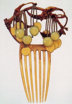 Lalique, c.1903, dyed horn, featured at the exhibit in Hakone, Japan. It was compared to a number of Edo combs, which had exactly the same kind of cherries painted on them.