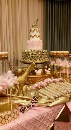 Pink and gold giraffe safari cake and dessert table by Honey's Cakes. www.honeyscakes.com   Cakepops, chocolate dipped pretzels, mini cupcakes.