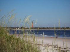 New Smyrna Beach, FL. matt and i walked up this lighthouse in july...looong ways up but so pretty!