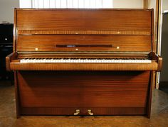 A 1971, A Steinway Model V upright piano with a mahogany case and polyester finish at Besbrode Pianos