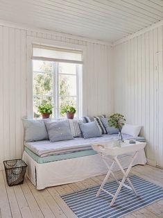 Whitewashed floors, crisp white beadboard walls and shades of coastal blue