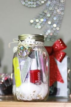 Mason Jar Full Of Manicure Necessities, Such As Nail Varnish, Nail File, Nail Clipper, Nail Varnish Remover Pads And Cotton Wool.