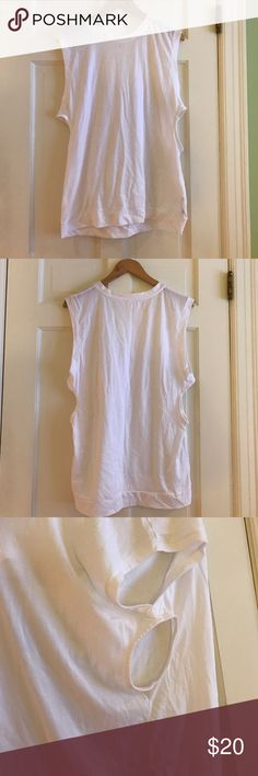 White Workout Tank w/ Side Cutouts I got this as a part of my Fabletics subscription and ended up deciding it was not for me. I have never worn it, it is in perfect condition. The fabric is great and my favorite to workout in. Fabletics Tops Tank Tops