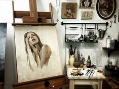 Another Art Studio..love the hanging baskets and side table! Also want some pretty pottery to keep my brushes in