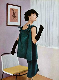 Myrtle Crawford in blue-green velvet tunic, the back swinging freely, tied with two bows at the shoulders by Balenciaga, photo by Pottier, 1955