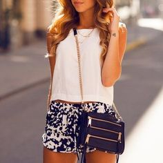 Navy and white shorts, white top