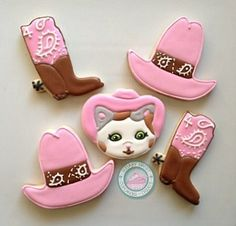 Meet the new sheriff in town! Sheriff Callie...Beloved children's character comes to life in this sweet set!Each cookie is handmade and carefully decorated just for you, never pre made!Set comes with 4 of each design shown:-Sheriff Callie face with pink hat (3.25in)-Cowgirl Hat in pink with brown paisley print (3.25in)-Cowgirl Boot in brown with pink and white paisley print (3.25in)Each cookie comes individually sealed and wrapped for max freshness and prot...