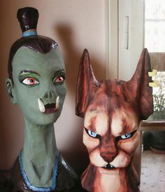 Two Skyrim girls. Natural size female heads made of :  plastic bottles, newspapers, mask tape, wood glue and plastic colors.
