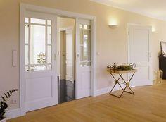 Puerta corredera salón madera