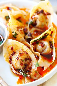 (Asian: Szechwan Cuisine)  Hong You Chao Shou-  These spicy red oil wontons are filled with chili oil and pork.