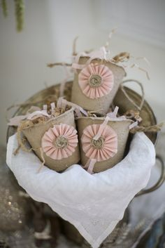 embellished peat pots... I have some of these for the christmas tree with pipe cleaner handles... like little treat pails.