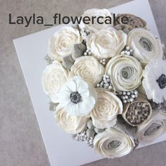 """Custom ordered buttercream flowercake decorated with peonies, """"hanoi"""" ranunculus, anemone and lotus pips in a """"bouquet"""" style"""