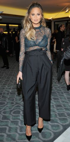 Chrissy Teigen pulled a Kim Kardashian for her latest maternity look and stepped out in her sexiest ensemble yet—a teal lace see-through Femme d'Armes top (with a matching lace bra) and black paperbag-waist pants that neatly covered her bump. Nye Outfits, New Years Eve Outfits, Christy Teigen, Chrissy Teigen Style, Stella Mccartney, Pregnancy Looks, Inspirational Celebrities, Party Fashion, Fashion 2016