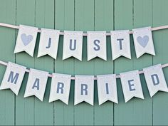 Different patterns: You'll print the letters individually, cut small slits in each, then string everything together. Find this one — along with matching 'Bride' and 'Groom' banners — here.
