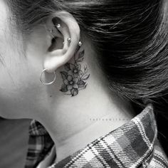 Behind-the-ear floral design by Tattoo With Me