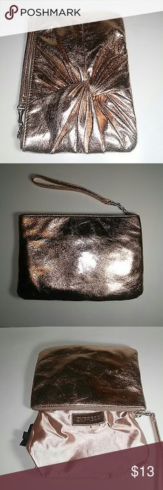 New Gold clutch New no tags gold cluth zipper closure and detachable  handle 6 inches long. By 9 inches wide great for makeup cell keys great for night on the town party  Shiny no inperfections comea from a smoke free pet free home it was stored in plastic away from humidity  Love this clutch Express Bags Clutches & Wristlets