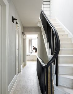 A natural lime-wash was applied to the walls in this stairway and hallway, which has a nuanced painterly look. The slightly rough texture and shadowy surface ground the space with depth and prevent it from feeling too new or pristine. They kept the existing oak floor but had it sanded and bleached