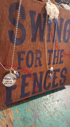 Swing for the Fences handpainted sign by Studio 11 Boutique Emporia KS. KC Royals inspired handmade jewelry.