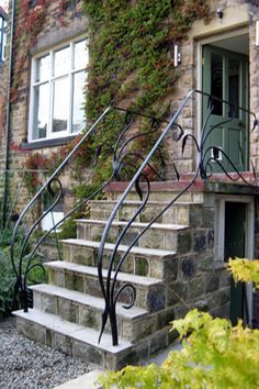 The design of these forged steel handrails was inspired by the flowing curves of Art Nouveau metalwork, they were designed and made by Verdigris, a contemporary forge and metalworking studio. Exterior Handrail, Outdoor Stair Railing, Metal Stair Railing, Metal Handrails, Wrought Iron Stair Railing, Staircase Handrail, Porch Handrails, Banisters, Garden Railings