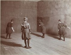Byron Collection, Four girls playing handball in an indoor court. Teachers College. 1904