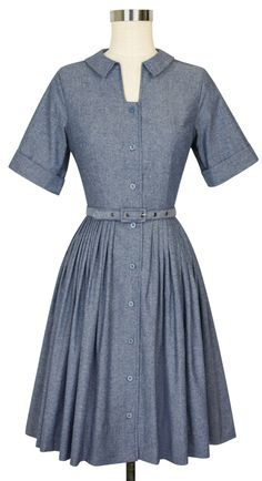 Trashy Diva's retro-inspired Chambray Collection is the perfect staple to every wardrobe. The Shirtwaist Dress exudes classic vintage fashion in chambray. The undeniably feminine silhouette features 3/4 length sleeves designed to be cuffed to your desired length for a lovely vintage look. Functional blue pearlescent buttons adorn the front center. The collar and fitted bodice add sleek sophistication to the pleated knee-length skirt with pockets. #trashydivachambray…