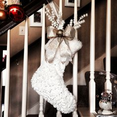 I found this white with silver sequins fur stocking at home goods!! I added the gold chevron bow, gold glittered ornament and white branches to it!! This is my stocking!! Christmas 2013