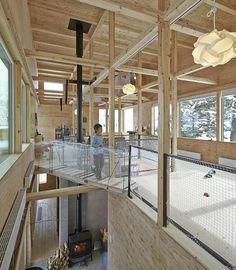 ryo yamada's nakanosawagawa house utiliizes a distinct tree house floor to add temporary dwellings that can change alongside the family.