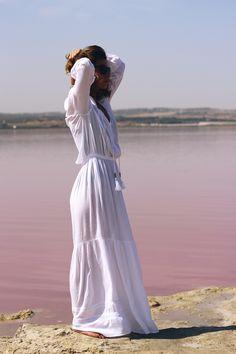 A maxi white dress and a pink lake