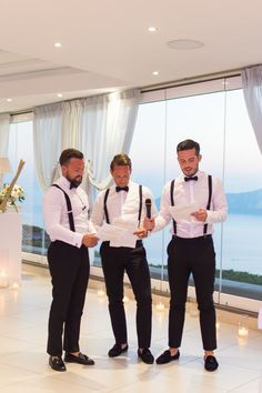 groomsmen in black and white and suspenders