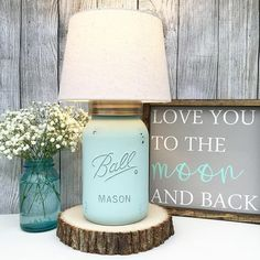 Mason Jar ideas lamp ideas #masonjar #masonjarlight #light #lamps #diy #masonjarideas #nursery #bathroom #readinglight #signs #quote #babyroom #baby #rustic #farmhouse #livingroom #livingroomlight #basementlight #indoorlights www.kainspired.com