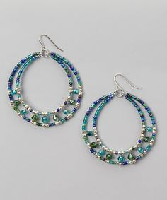 Stylishly sea-inspired, these hoop earrings come ready to imbue a sense of calm serenity into any ensemble with their tranquil blue-green hue and glass beads.
