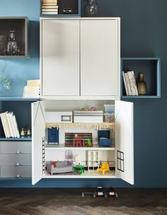 You don't need fill your living room with brightly-colored kid's furniture so the children can play. IKEA has a lot of modern furniture such as cabinets from the EKET series that can be used for storage as well as for building a secret doll's house.