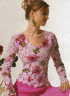 How pretty....This site has some stunning floral crochet dresses and tops