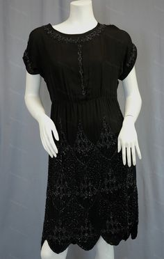 Vintage Flapper dress of silvery beaded black silk with scalloped hem circa 1920s from Recursive Chic @ recursivechic.com