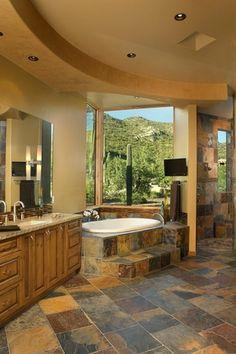 Rustic Master Bathroom with Arizona Tile, Multi Slate, Slate., Frameless glass shower door, Mirror mounted sconces, Flush