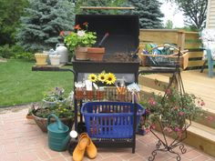 Potting Bench.  Turned my old gas grill into a Potting Bench.  Leave one grate on, so when you fill your pot anything that spill falls through the grate.  Write the names of your plants on plastic knives to mark your plants.  Fill..plant...water...enjoy !