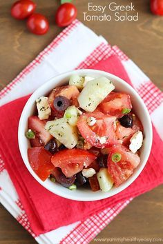 Greek Tomato Salad | easy salad made with tomatoes, cucumbers, olives, green onions & feta cheese and tossed with a homemade dressing. Delicious!