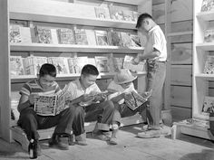 Reading comic books in the Tule Lake Relocation Center (California, 1942)