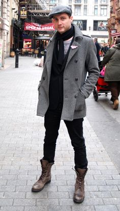 Shop this look for $228:  http://lookastic.com/men/looks/pea-coat-and-flat-cap-and-scarf-and-blazer-and-chinos-and-boots-and-crew-neck-t-shirt/549  — Grey Pea Coat  — Grey Vertical Striped Flat Cap  — Black Scarf  — Black Blazer  — Black Chinos  — Brown Leather Boots  — Grey Crew-neck T-shirt