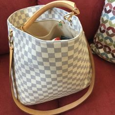 Sold out! Authentic Soffi Louis Vuitton ‼️Please do not bundle‼️Authentic Louis Vuitton Soffi Damier Azur – crafted of LV signature damier check canvas in azur.  Bag features vachetta cowhide leather including a broad reinforced looping shoulder or clutch handle with polished brass hardware and a longer optional shoulder strap.    Condition: Canvas is very good, with some handle markings.  Inside very clean with a small ink mark by inside pocket.  Purchased in Sept 2014 – authenticity serial…