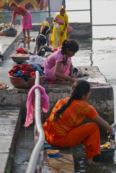 several woman were washing clothes at the Udaipur Ghats -- a series of steps leading down to Lake Pichola. By Peter Cook UK
