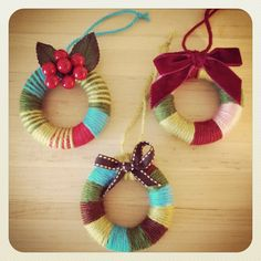 yarn wreaths via Hillary Lang on flickr. I think these are super cute.
