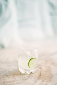 Refreshing cocktail with a slice of lime. Photography by gerdemark.se, Floral + Event Design by bloomzflowersbali.com, Read more - http://www.stylemepretty.com/2013/06/20/bali-wedding-from-erika-gerdemark-photography/