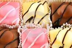 A closeup of colorful iced fondant cakes