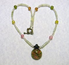 Yellow, Green, Pink and Peach Dichoric Glass Pendant on a Necklace of Jadeite, Crystals and CZs