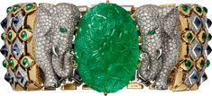 Cartier. Bracelet - platinum, yellow gold, one 79.50-carat carved emerald from Colombia, cabochon-cut emeralds, cabochon-cut sapphires, emerald eyes, brilliant-cut diamonds. CartierMagicien
